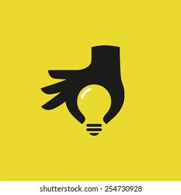 Human hand silhouette with idea light bulb. Concept design, vector illustration.