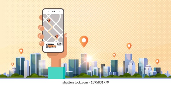 human hand using online ordering taxi car sharing mobile application concept transportation carsharing service app smartphone screen with gps map modern cityscape background horizontal