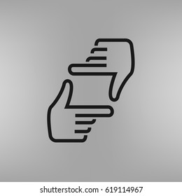 Human hands doing cropping symbol