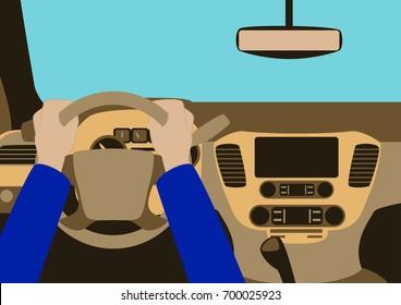 Human hands driving a car