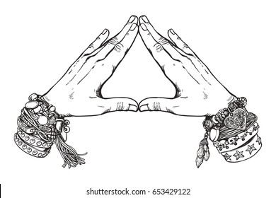 Human hands make triangle shape isolate on white background.Illuminati sign. Sacred geometry. Religion, spirituality, occultism, alchemy magic. Vintage boho style accessories with hippie bracelets.