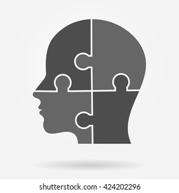Human head made of puzzle pieces icon