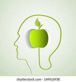 Human head with paper green apple - symbol Freedom and creativity