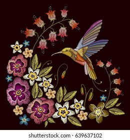 Humming bird and beautiful flowers embroidery on black background. Elegant flowers and tropical humming bird vector. Decorative floral embroidery. Template for sewing, clothing, textiles