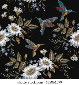 Humming bird and chamomile embroidery seamless pattern. Beautiful hummingbirds and white chamomile embroidery on black background. Template for clothes, textiles, t-shirt design