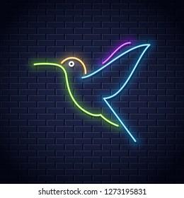 Hummingbird neon logo design. Colibri bird neon icon on wall background