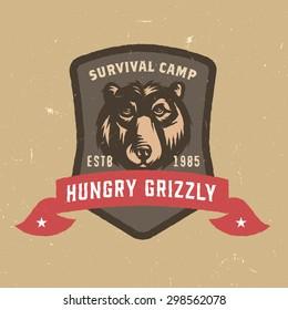 Hungry Grizzly Survival Camp Distressed T shirt Apparel print. Vintage Americana Style Tee Graphics. Vector Illustration. Travel Souvenir Idea. Retro Badge Emblem Logo Design