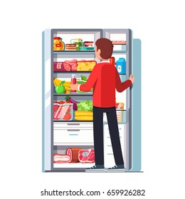 Hungry or thirsty man taking out juice bottle from refrigerator full of vegetables, fruits, meat and dairy products. Open single door fridge with freezer. Flat style vector isolated illustration.