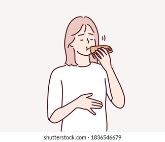 Hungry young woman eating sandwich. Hand drawn style vector design illustrations.