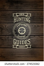 Hunting badges logos and labels for any use, on wooden background texture