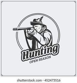 Hunting club emblem. Hunter with a gun.