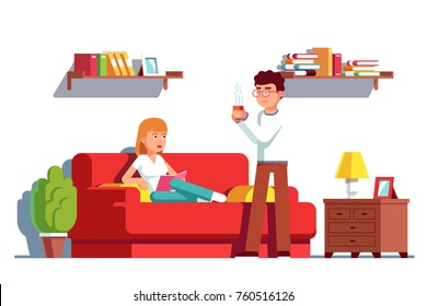 Husband and wife relaxing at home living room interior. Man brings hot coffee cup to woman lying on sofa reading book. Flat vector character illustration isolated on white background.