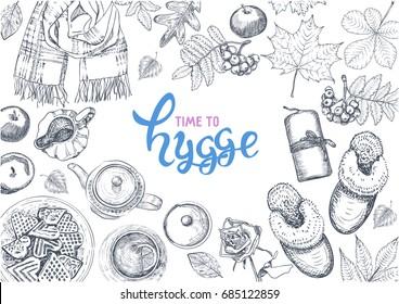 Hygge is a Danish living concept. Vector template with hand drawn illustrations cozy home things: candles, scarf, slippers, tea and cookies, autumn leaves, apples. Sketch style and lettering.