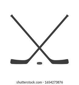 Ice hockey crossed sticks and puck icon Black silhouette isolated on white background. Sport equipment symbol. Vector illustration.