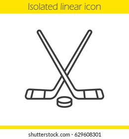 Ice hockey equipment linear icon. Thin line illustration. Crossed hockey sticks and rubber puck. Contour symbol. Vector isolated outline drawing