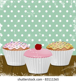 iced cupcakes in white cases on a distressed retro style background