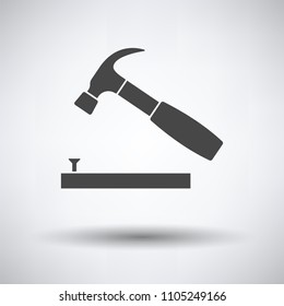 Icon of hammer beat to nail on gray background, round shadow. Vector illustration.