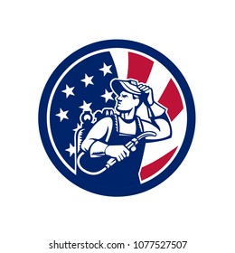Icon retro style illustration of an American lit operator or welder with visor holding welding torch with United States of America USA star spangled banner or stars and stripes flag inside circle