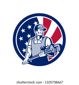 Icon retro style illustration of an American plumber and Pipefitter  holding monkey wrench with United States of America USA star spangled banner stars and stripes flag in circle isolated background.