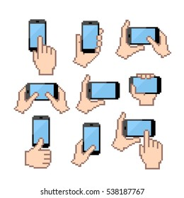 Icon set of hands holding smartphone. Flat pixel vector icons.