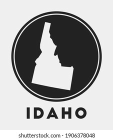 Idaho icon. Round logo with us state map and title. Stylish Idaho badge with map. Vector illustration.