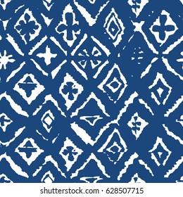 Ikat blue mosaic indigo shibori seamless pattern in vector. Modern batik print.