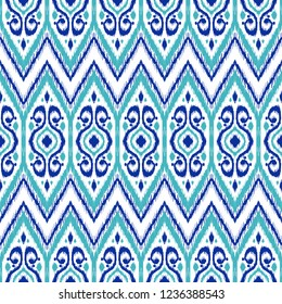 Ikat geometric folklore pattern. Ethnic folk ornament texture. Tribal mengikat textile. Aztec, Indian, Scandinavian, Gypsy or Mexican fabric.