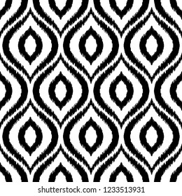 Ikat ogee seamless pattern. Can be used for textile, wallpaper, wrapping paper, greeting card background, phone case print. Black and white graphic vector design. Abstract ornament in ethnic style.