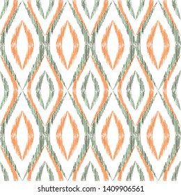 Ikat ogee seamless vector pattern illustration. Ethnic fabric print geometric ikat pattern. Smooth ogee seamless repeating background. Tribal motifs ikat textile print design. Clothes ornament.