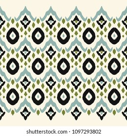 Ikat seamless border print. Vector tie dye shibori pattern with stripes and chevron. Ink textured japanese background. Ethnic fabric vector. Bohemian fashion. Endless watercolor texture. African rug.