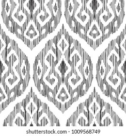 Ikat seamless pattern in damask, oriental, indian, marrocan style. Vector background. Black and white texture graphic. Ethnic design for fashion textile prints, wallpapers, cards or wrapping papers.