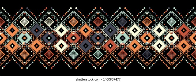 Ikat seamless pattern. Tribal art print. Chevron geometric background. Abstract zigzag pattern for cover design