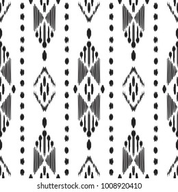 Ikat seamless pattern. Vector background. Black and white ethnic design for fashion textile prints, wallpapers, cards or wrapping papers.
