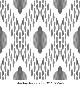 Ikat seamless pattern. Vector background. Black and white texture graphic. Ethnic design for fashion textile prints, wallpapers, cards or wrapping papers.