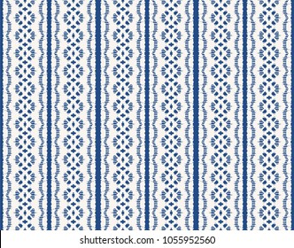 Ikat seamless pattern. Vector tie dye shibori print with stripes and chevron.