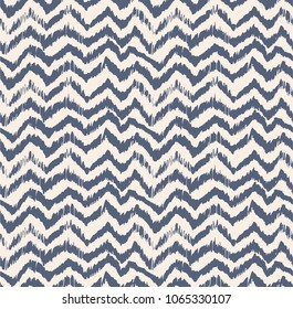 Ikat seamless pattern. Vector tie dye shibori print with stripes and chevron. Ink textured japanese background. Ethnic fabric vector. Bohemian fashion. Endless watercolor texture. African rug.