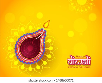 Illuminated oil lamp (Diya) on yellow floral pattern background for Happy Diwali celebration can be used as greeting card design.