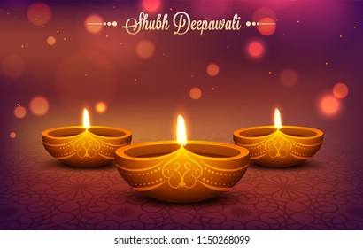 Illuminated oil lamps (Diya) on shiny bokeh effect background for Shubh Deepavali festival celebration concept.