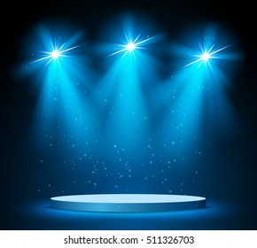 Illuminated round stage podium on dark background