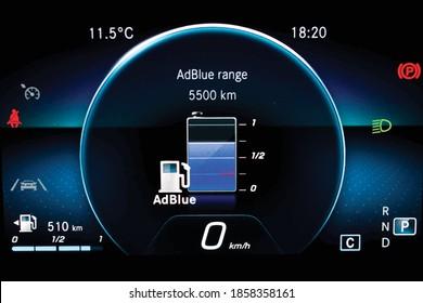 Illustration of AdBlue level indicator on illuminated car dashboard. Car instrument panel with speedometer, fuel gauge, seat belt reminder Urea level display on car cluster. Check diesel exhaust fluid
