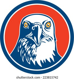 Illustration of an american bald eagle head facing front set inside circle on isolated background done in retro style.