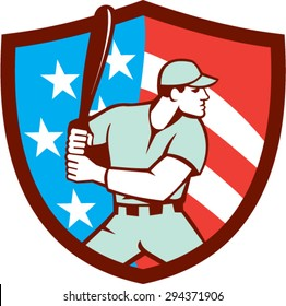 Illustration of a american baseball player batter hitter holding bat viewed from the side set inside shield crest with usa flag stars and stripes in the background done in retro style.