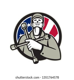 Illustration of an American tire mechanic wearing hat holding tire wrench 4-way lug wrench or tyre iron on chest looking up inside circle with USA flag stars and stripes in background in retro style.