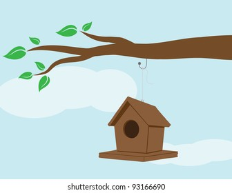 Illustration of a birdhouse hanging on a branch.