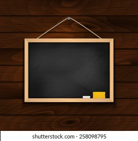 Illustration of blank black chalkboard with chalk and eraser on wood background