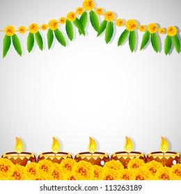 illustration of burning decorated diya on colorful rangoli
