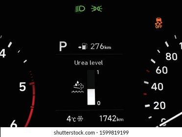 Illustration of close up of urea level indicator on car dashboard located between speedometer and tachometer. Car instrument panel with traction control warning light, low beam, side light indicators.