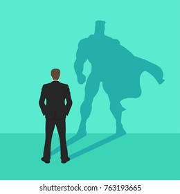 illustration of a confident handsome business man standing with his arms folded with superhero shadow
