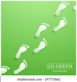 Illustration of eco friendly footprints on green background