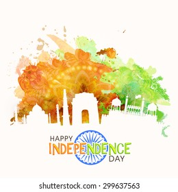 Illustration of famous Indian monuments on saffron and green color splash floral background for Happy Independence Day celebration.